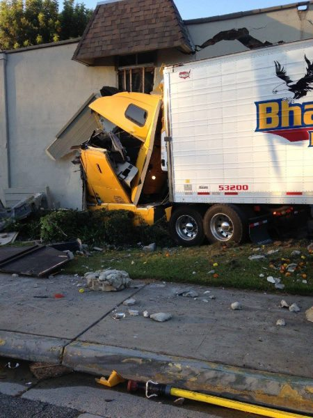 Five Hurt After Semi Crashes Into California Apartment Building