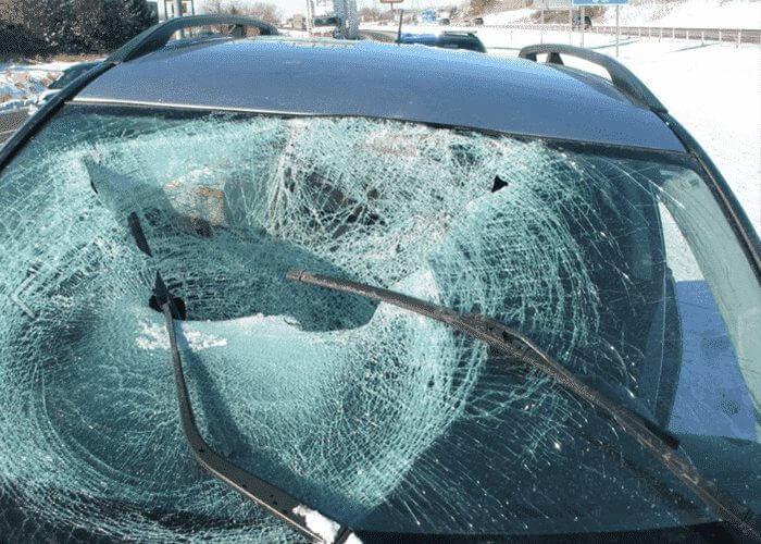 Motorist Injured By Ice Chunk From Semi