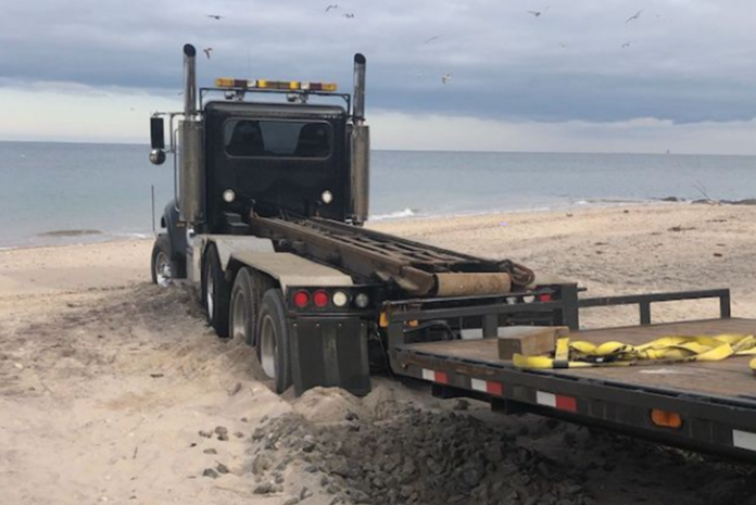 Police puzzled by driver who abandoned big rig on the beach