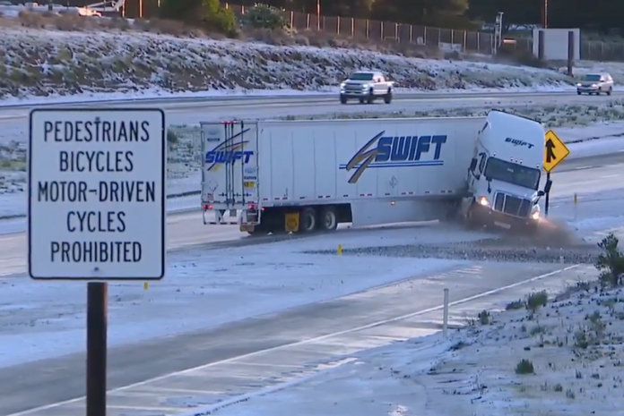 News crew catches semi truck jackknifing on black ice